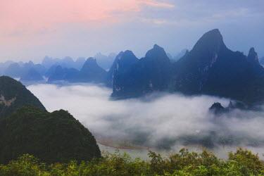 AS07_KSU1268_M Karst hills in morning mist, Li River area, Yangshuo, Guangxi, China