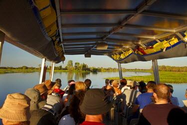 AU01_DWA4276_M Yellow Water Cruise Boat, Yellow Water Billabong, Kakadu National Park, Northern Territory, Australia