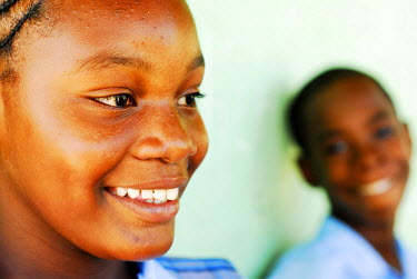 CA03_AAS0013_M Antigua, St John, close-up of an African schoolgirl with a friend in the background (MR)