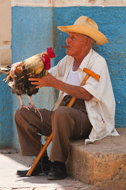 CA11_MDE0137_M Trinidad, Cuba. Cuban gentleman and his fighting cock,  UNESCO World Heritage Site.