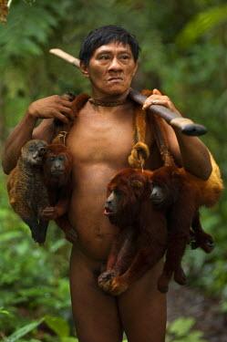 SA07_POX1882_M Huaorani Indian - Ontagamo Kaimo carrying a peccary that he hunted for food. Gabaro Community. Yasuni National Park. Amazon rainforest, Ecuador.