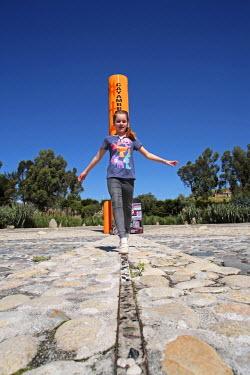 ECU1170 Girl walking along the equator, Cayambe, Ecuador