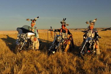 USA8402AW Three Native Indians on Bikes, Lakota, South Dakota, USA MR