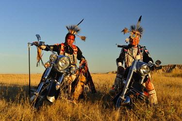 USA8403AW Three Native Indians on Bikes, Lakota, South Dakota, USA MR