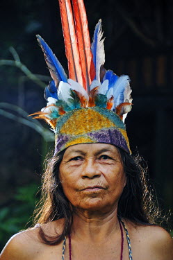 COL0080AW Indian woman with head dress, Ticuna Indian Village of Macedonia, Amazon River, near Puerto Narino, Colombia