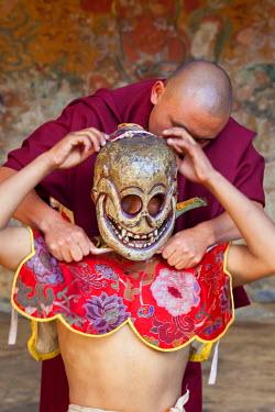 BX01053 Dancers preparing, Tamshing Phala Chhoupa festival, Tamshing Monastery, nr Jakar, Bumthang, Bhutan