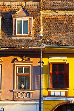 RM01294 Old woman at window, Medieval Old Town, Sighisoara, Transylvania, Romania