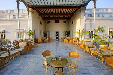 IND6855 India, Andhra Pradesh, Hyderabad. The Gol Bungalow, a glass-roofed open terrace, at the luxury Falaknuma Palace Hotel.