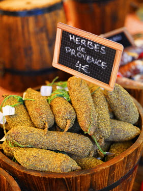 FRA7365AW France, Provence, Arles, market, Herbs and sausages