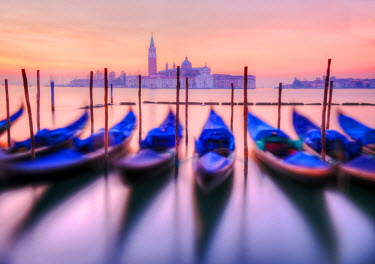 ITA1392AW Moored gondolas with San Giorgio Maggiore in the background at dawn, Venice, Veneto region, Italy