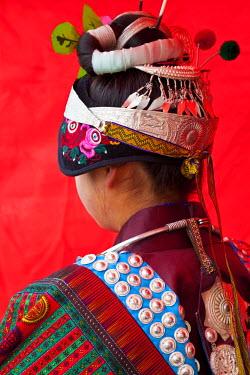 CN06381 Young Black Miao girl preparing for festival, Kaili, Guizhou Province, China