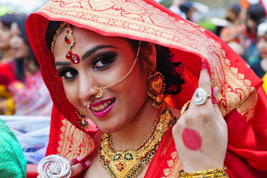 TPX32269 England, London, Banglatown, Bengali New Year Festival, Boishakhi Mela Parade, Girl in Bridal Costume