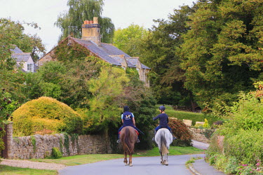 EU33TNO0015 Riders enjoy a rural village in Cotswolds in Southwestern England