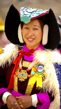 Ladakh, India. The amazing and unique costumes and jewelry on display as the local ethnic Ladakhis perform traditional dances in the shadow of the Himalayan mountains.