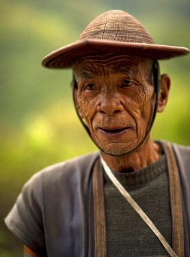AS10JMS0251 Portrait of a elderly tribal man. Rural Arunachal Pradesh, India.