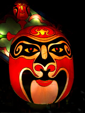 AS32JMS0006 Singapore, China. Silk lanterns portraying mythological characters, lighting up the night sky during the Mid Autumn Lantern or Mooncake festival