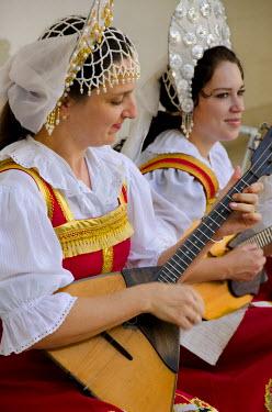 AS43CMI0228 Ukraine, Yalta, Livadia Palace. Ukrainian folkloric show. Women in traditional costumes playing Russian balalaikas and lutes.