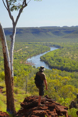 AU01DWA4572 Hiker and view from the Escarpment Walk, over Victoria River Valley, Gregory National Park / Jutpurra National Park, Northern Territory, Australia (MR)