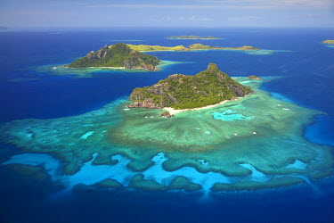OC01DWA0169 Monuriki Island and coral reef, Mamanuca Islands, Fiji, South Pacific, aerial