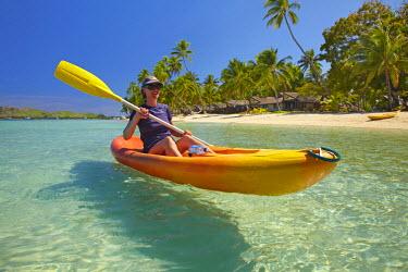 OC01DWA0203 Kayaker, Plantation Island Resort, Malolo Lailai Island, Mamanuca Islands, Fiji, South Pacific. (MR)