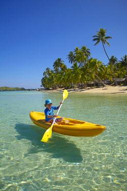 OC01DWA0219 Young kayaker, Plantation Island Resort, Malolo Lailai Island, Mamanuca Islands, Fiji, South Pacific. (MR)