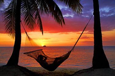 OC01DWA0233 Hammock and sunset, Plantation Island Resort, Malolo Lailai Island, Mamanuca Islands, Fiji, South Pacific. (MR)