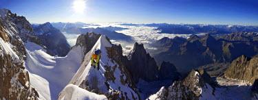 AR4431000071 Chamonix, Haute Savoie, France: Alpinist On The Steep Snow Crest Of The Innominata Ridge At Sunrise On The Huge South Face Of Mont Blanc,  Chamonix France