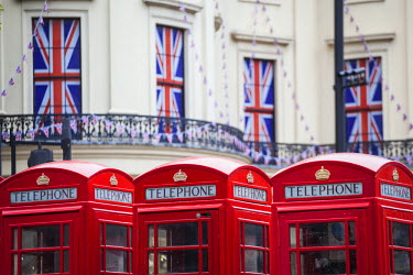 UK10590 UK, England, London, The Strand, Red telephone box and Union Jack bunting to celebrate the Queens Diamond Jubillee