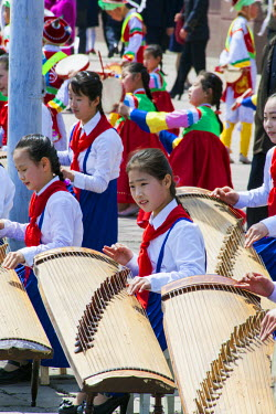 NK01077 Democratic Peoples's Republic of Korea (DPRK), North Korea, Pyongyang, school children playing music during street celebrations on the 100th anniversay of the birth of President Kim IL Sung, April 15t...