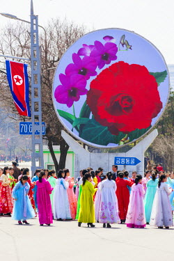 NK01080 Democratic Peoples's Republic of Korea (DPRK), North Korea, Pyongyang, women in traditional dress dancing during street celebrations on the 100th anniversay of the birth of President Kim IL Sung, Apri...