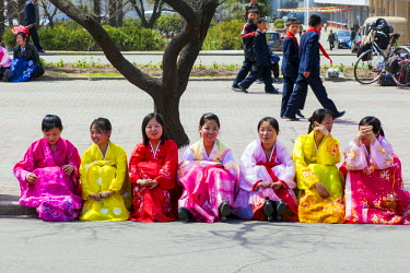 NK01083 Democratic Peoples's Republic of Korea (DPRK), North Korea, Pyongyang, women in traditional dress dancing during street celebrations on the 100th anniversay of the birth of President Kim IL Sung, Apri...