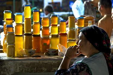 AR4587900042 Ashgabat, Turkmenistan : Honey Vendor At The Tikinske Bazaar,  Ashgabat,  Turkmenistan