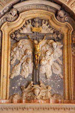 BRA0648AW Brazil, Bahia, Salvador, a rococo crucifix in the chapel of the Convento do Carmo hotel in Salvador