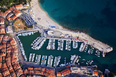 HMS376128 France, Bouches du Rhone, beach and habour of the village of Cassis (aerial view)