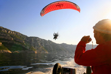 HMS607946 France, Bouches du Rhone, paramotor in the rocky creeks (aerial view) (Calanques National Park since 2012/04/18)