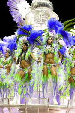 BRA0800AW South America, Rio de Janeiro, Rio de Janeiro city, costumed dancers wearing feathers at carnival in the Sambadrome Marques de Sapucai