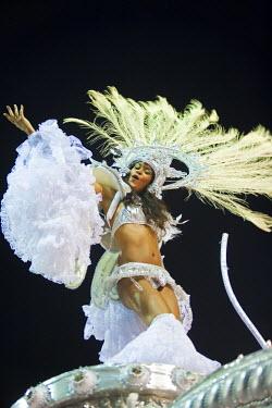 BRA0840AW South America, Rio de Janeiro, Rio de Janeiro city, costumed dancer in a headdress at carnival in the Sambadrome Marques de Sapucai