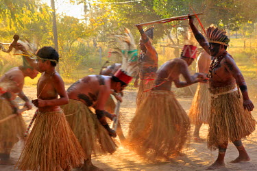 BRA0935AW South America, Brazil, Miranda, Terena indigenous people from the Brazilian Pantanal performing a ritual stick dance in grass skirts