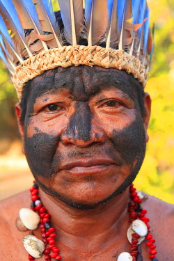 BRA0938AW South America, Brazil, Miranda, Terena indigenous man from the Pantanal in a Macaw feather headdress