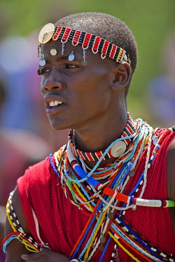 KEN7981 A Maasai schoolboy in traditional attire sings during an inter-schools song and dance competition, Kenya