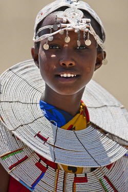 KEN7985 A young Maasai girl at Magadi. The circular markings on her cheeks as well as her white beaded ornaments denote that she is a Kisongo Maasai, Kenya