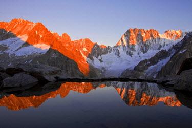 HMS481828 France, Haute Savoie, Chamonix Mont Blanc, Michel Tavernier lake with the reflection of Grandes Jorasses