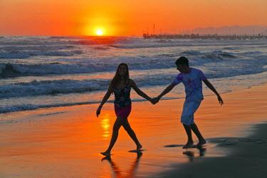 ITA1434 Italy, Forte dei Marmi. A romantic stroll along the beach at sunset.
