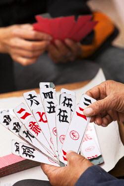 CH9932 China, Yunnan, Yuanyang. Enjoying a game of cards.