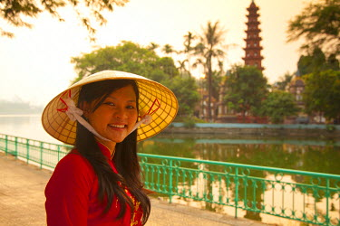 VN02234 Girl wearing Ao Dai dress, Tran Quoc Pagoda, West Lake (Ho Tay), Hanoi, Vietnam (MR)