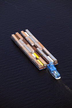 BRA1181AW Brazil, Amazonas, container barge and tug on the Rio Negro in Manaus in the Brazilian Amazon
