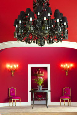 BRA1214AW Brazil, Rio de Janeiro city, Joatinga, La Suite Hotel, lobby area of the hotel showing pink chairs and chandelier PR