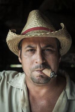 CB01165 Cuba, Pinar del Rio Province, Vinales, Vinales Valley, tobacco planter smoking Cuban cigar