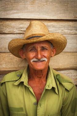 CB01166 Cuba, Pinar del Rio Province, Vinales, Vinales Valley, tobacco planter