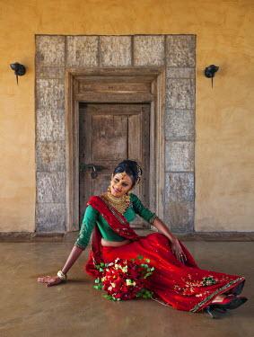 SRI1482 A pretty Sinhalese lady in her wedding outfit, Kandalama, Sri Lanka
